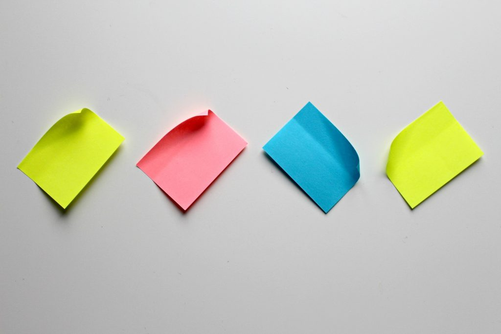 colourful sticky notes on a wall